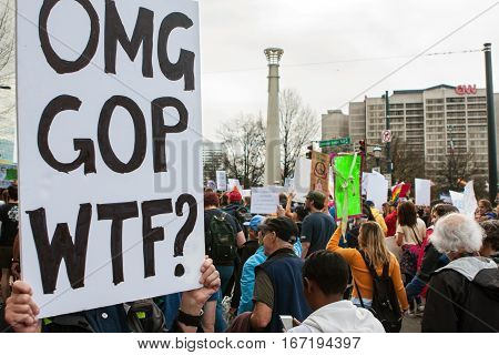 ATLANTA, GA - JANUARY 2017:  A woman holds a sign that says
