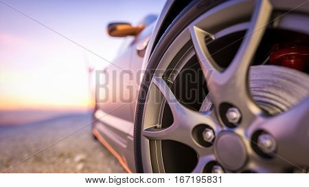 Close-up photos wheel sport. The scene behind as the sun going down with wind turbines in the back.