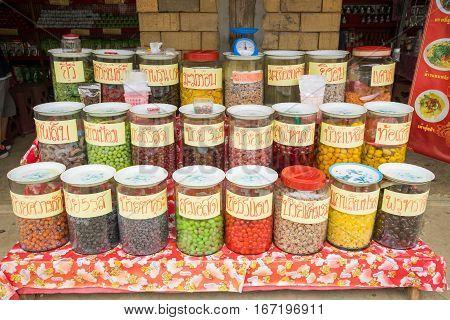 MAE HONG SON, THAILAND - JAN 2, 2017: A lot of fermented fruits in jars for sale at Rak Thai Village, Mae hong son, Thailand