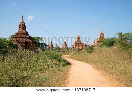 Buddhist temples of an ancient Pagan kingdom in the sunny day. Old Bagan. Myanmar