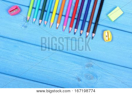 Colorful Crayons, Sharpener And Eraser On Blue Boards, School Accessories, Copy Space For Text