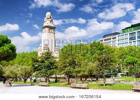 Eastern Side Of The Cervantes Monument On The Square Of Spain (plaza De Espana) On The Blue Sky Back