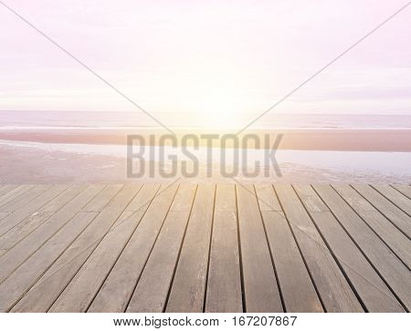 wood floor with sun shine on beach  - can be used for display or montage your products