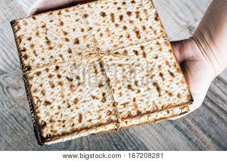 Jewish matza on Passover in hand Traditional Jewish food