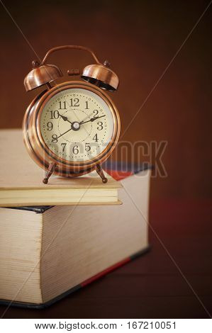 clock alarm books book old retro table time education vintage concept library stack background antique up reading literature floor art watch morning closeup history brown paper wood knowledge wisdom alarm-clock clocks school open