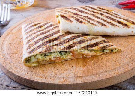 Mexican food fajitas served on wooden board
