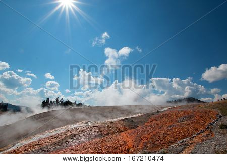 Steaming Water Run Off From The Excelsior Geyser In Yellowstone National Park In Wyoming Usa