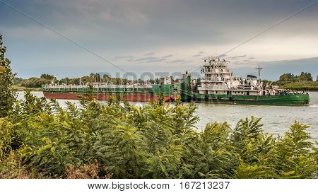 Russia Starocherkassk - the capital of the Don Cossacks . Don - father near the town. Barges and ships on the river .