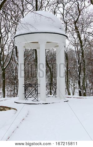 Arbour in winter snow-covered park Gomel Belarus
