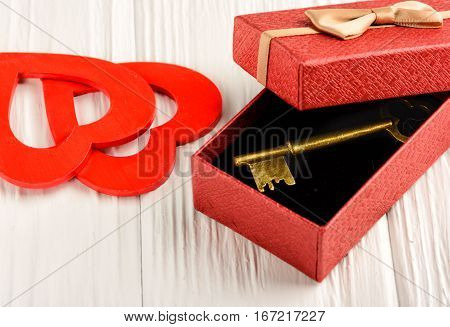 Gift by St. Valentine's Day in a red box on a white background
