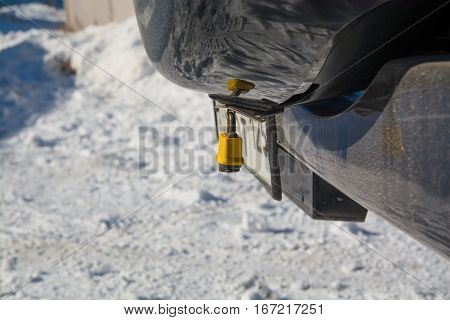 Padlock on compartment spare wheel. Yellow item.