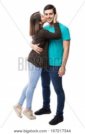 Young Man Getting A Kiss From Girlfriend