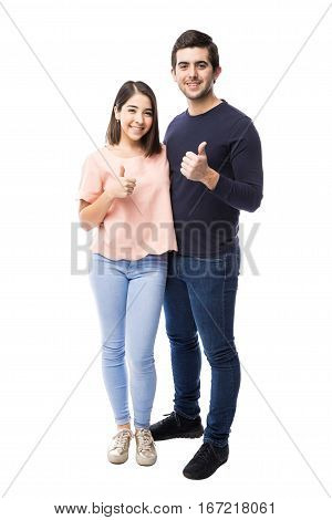 Attractive Couple With Thumbs Up