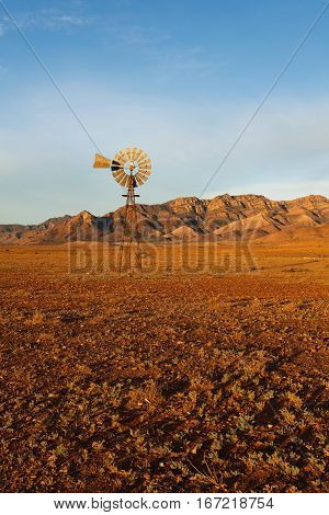 Windmill in the Australian outback - Red dirt - Flinders Range National Park, South Australia, Australia.