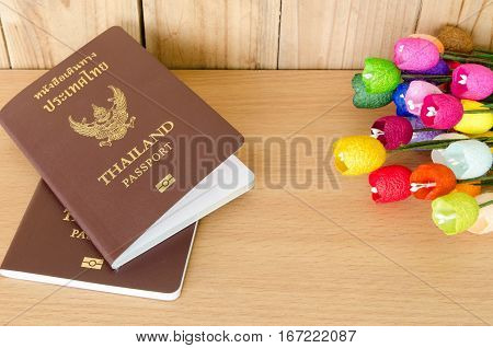 passport notebook and pen on wooden table