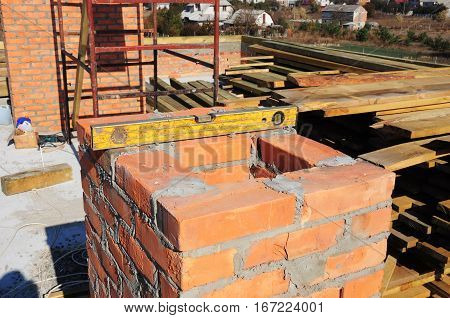 Building a Brick Chimney. Masonry Chimney Construction - Brick Laying Tools Spirit Level. How To Build a Fireplace Chimney