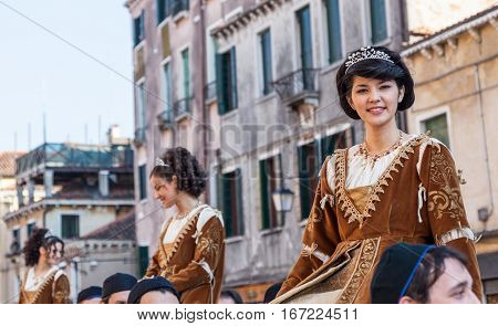 Venice Italy- February 26th 2011: Image of pretty young medieval ladies during a parade of traditional costumes in Venice during The Carnival days.