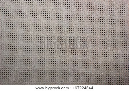 White beige velvet perforated leather texture background suede dots