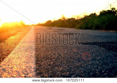 Road ahead and the sunset colored background