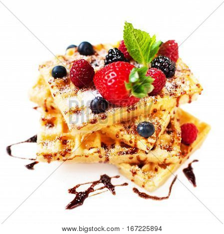 Belgian waffles with ice cream and berry fruits isolated on white background