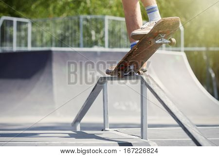 Skater Doing Nose Grind On Fun-box In Skatepark