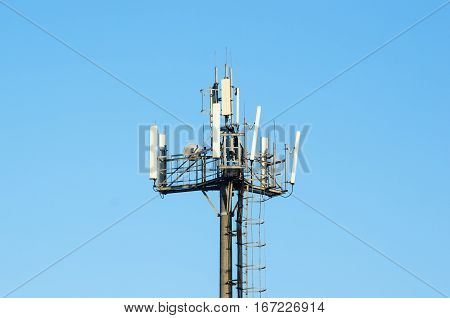 Modern antenna cellular networks against the with flat parabola on blue sky