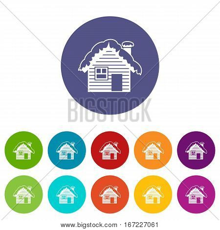Wooden house covered with snow set icons in different colors isolated on white background