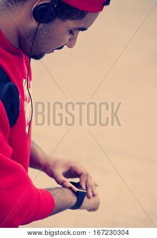 Young Black Guy Using Smart Wrist Watch
