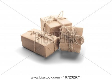 Boxes With Gift Wrapped In Kraft Paper On Isolated Background