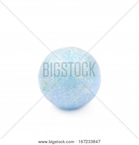 Single blue colored foam ball or a corn cereal candy isolated over the white background