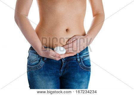 Female stomach and hands holding egg. IVF, pregnancy concept.
