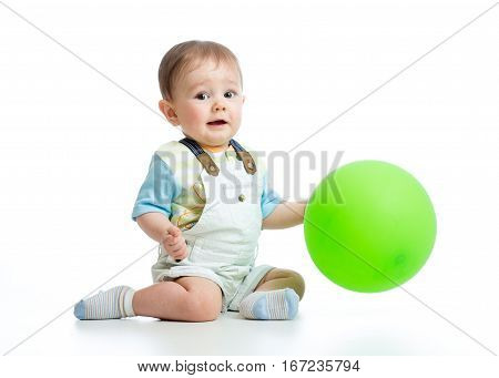 Happy baby boy with green ballon isolated on white background