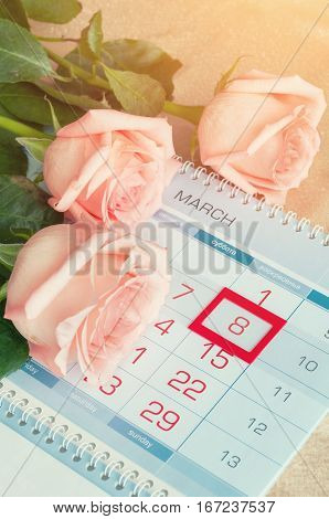 8 March card - peach roses over the calendar with framed 8 March date. 8 March is international women day