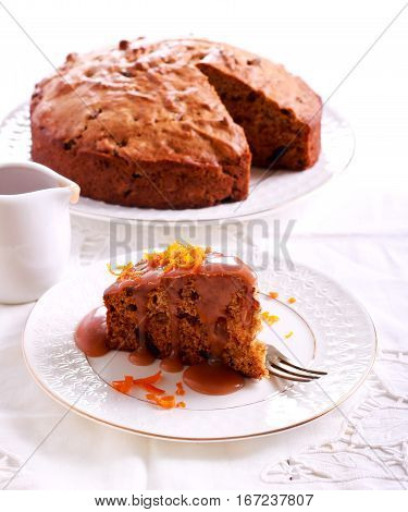 Sticky toffee pudding with caramel sauce over