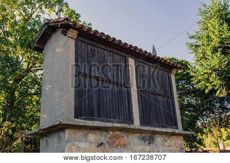 Typical galician horreo in palas de rei galicia Spain. Horreo is a granary made in wood and stone