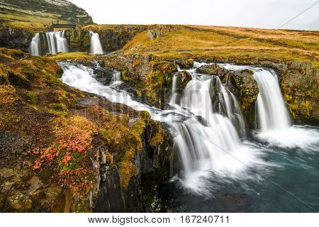 flowing water of icelandic waterfall beautiful autumn landscape near Kirkjufell mountain in the Snaefellsnes Peninsula and famous natural landmark of west Iceland