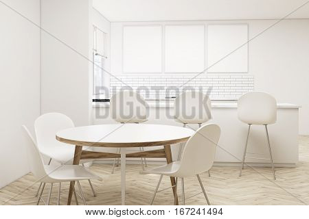 Kitchen With Bar, Round Table And Posters