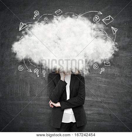 Young woman with head in the clouds. Chalkboard background. Daydreaming concept