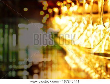 blur light drinking glass in pub or bar in dark night background