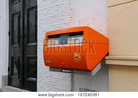 Utrecht the Netherlands - February 13 2016: Orange postbox on the wall of city building