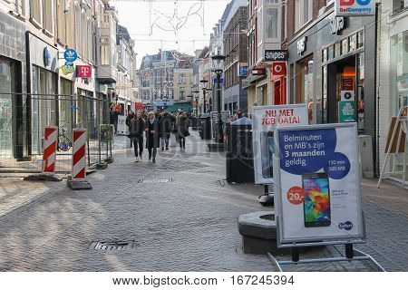 Utrecht the Netherlands - February 13 2016: People walking along the street in historic city centre