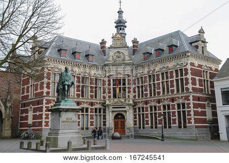 Utrecht the Netherlands - February 13 2016: University Hall of Utrecht University and statue of Count (Graaf) Jan van Nassau in Dom Square