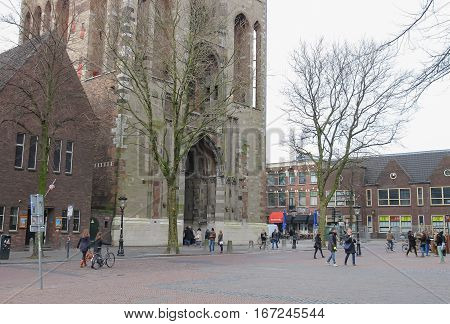 Utrecht the Netherlands - February 13 2016: People near arch passage of Cathedral Tower in historic city centre