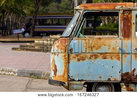 Rusted carcass of old abandoned Net Van.Thailand