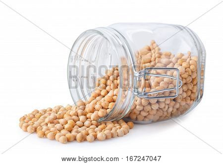 transparent glass jar with chickpeas isolated on white background. Uncooked dry chickpeas scattered out of glass container