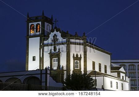 Tower of St. Sebastian church (Igreja Matriz de Sao Sebastiao) in evening sunset