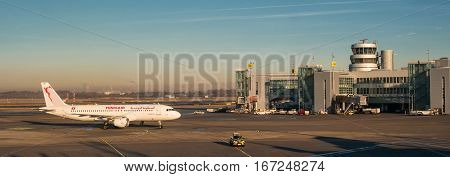 Dusseldorf, Germany - January 21, 2017: The plane landed and moves to the terminal. Before traveling by plane escort vehicle.