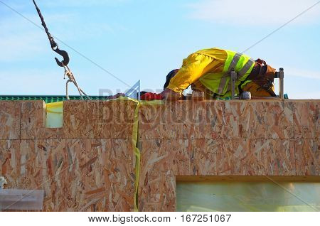 KYIV, UKRAINE - March 1, 2017:  Contractor Building New Modular Frame Plywood Board Panel Walls House on the Building Site. Structural Insulated Panels House