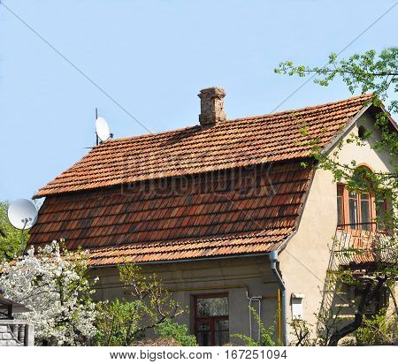 House renovation with roofing old ceramic tiles. Close up on roofing with old ceramic tiles.