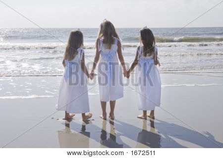 Portrait Of Three Sisters At The Beach
